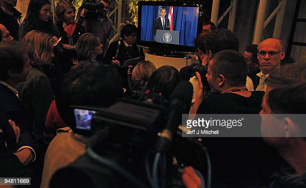 Journalists listen to US President Barack Obama talking from the airport on the final day of the UN Climate Change Conference on December 18 2009 in...