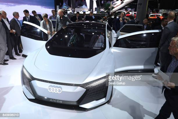 Journalists look at an Audi Aicon autonomous electric car at the Volkswagen Preview Night prior to the 2017 Frankfurt Auto Show on September 11 2017...