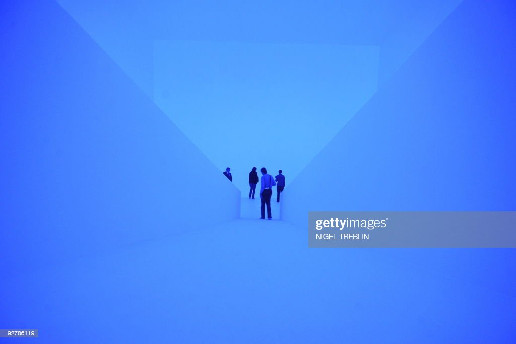 Journalists look at the light installation 'Bridget Bardo' by US artist James Turrell in the northern German city of Wolfsburg on October 22 2009 The...