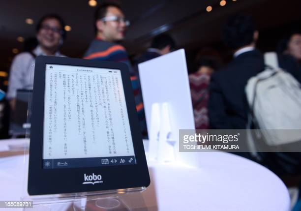 Journalists look at the new electronic book reader 'Kobo glo' from Japanese electronic commerce and Internet company Rakuten during a press preview...