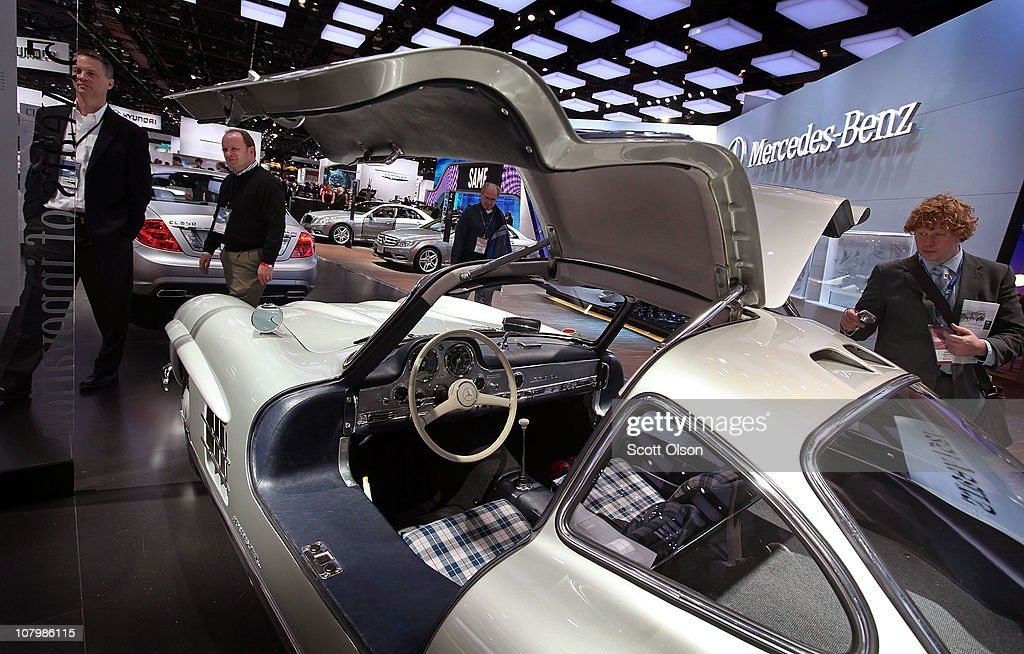 Journalists look over a 1954 Mercedes-Benz 300SL on display during the press preview of the North American International Auto Show at the Cobo Center on January 11, 2011 in Detroit, Michigan. The show is currently opened only for media previews and opens to the general public January 15-23.