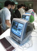 Journalists looks at iMac DV special edition and other updated versions of the iMac computer in Tokyo 07 October 1999 Apple computer Japan announced...