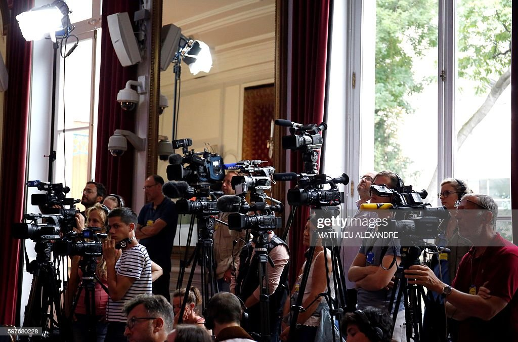 Journalists looks on during a press conference of French Minister of Interior Bernard Cazeneuve following a meeting with representatives of the...