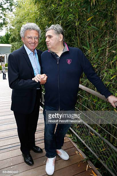 Journalists Nelson Monfort and Pierre Menes attend Day Seven of the 2016 French Tennis Open at Roland Garros on May 28 2016 in Paris France