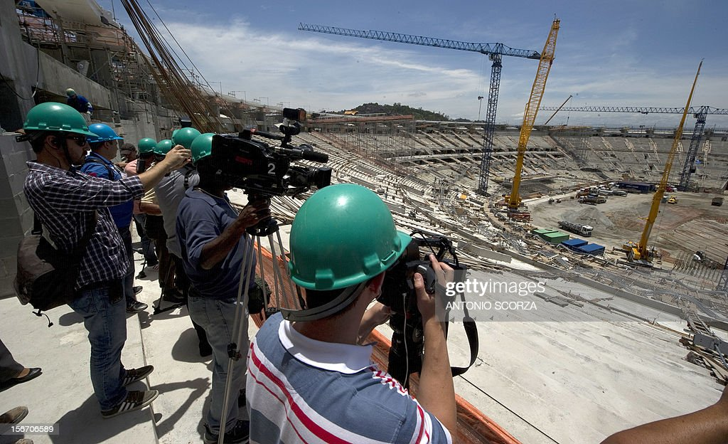 Journalists observe the works at Maracana stadium during a tour organized by the Rio 2016 Committee on November 19, 2012 in Rio De Janeiro, Brazil. AFP PHOTO/ANTONIO SCORZA