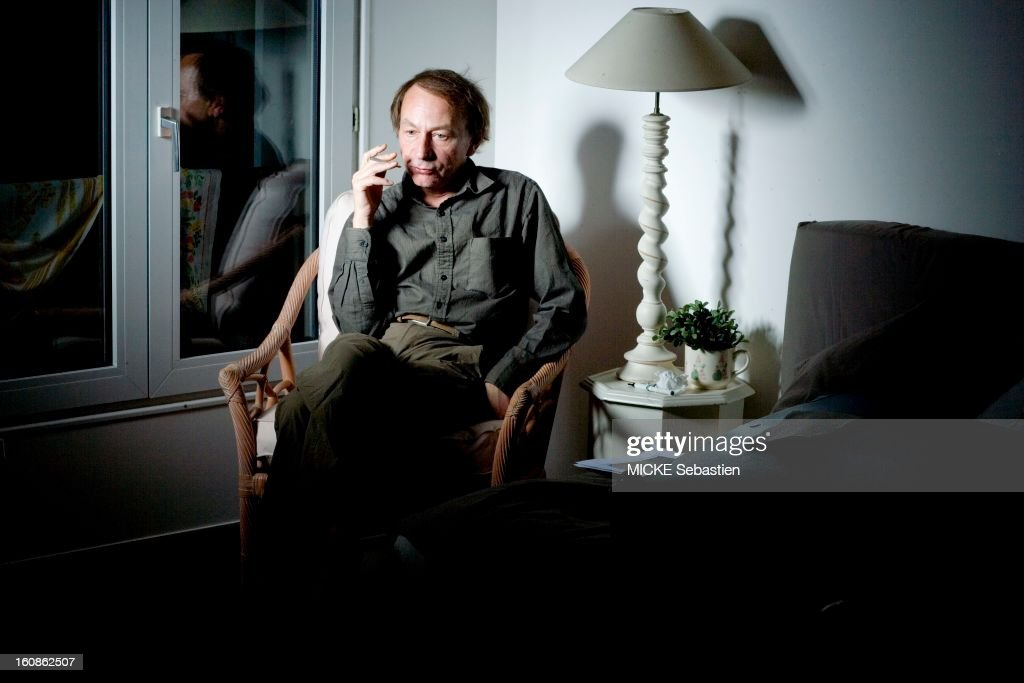 Journalists of 'Paris Match' <a gi-track='captionPersonalityLinkClicked' href=/galleries/search?phrase=Michel+Houellebecq&family=editorial&specificpeople=2164957 ng-click='$event.stopPropagation()'>Michel Houellebecq</a> has met PARIS for the release of his book 'Public Enemies', published by Flammarion Grasset, compiling secret correspondence he exchanged with philosopher Bernard-Henri Levy. The writer sitting on a chair in his room, smoking a cigarette, thoughtfully.