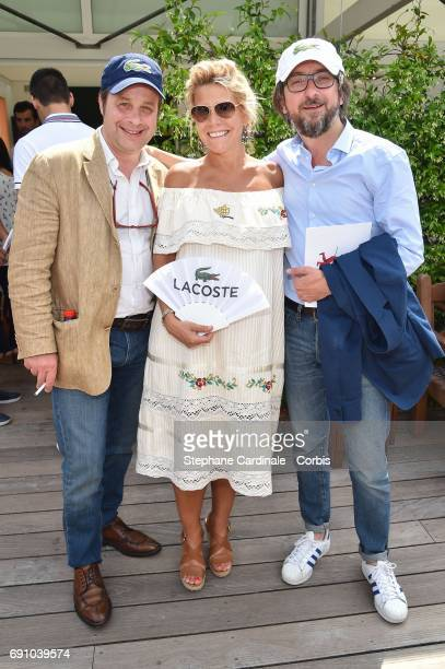 Journalists of TV progam 'Tele Matin' Patrice Romedenne Laura Tenoudji and Alex Jaffray attend the 2017 French Tennis Open Day Four at Roland Garros...