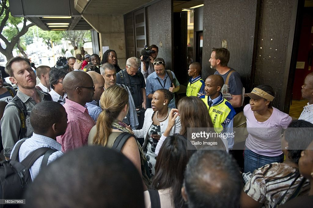 Journalists outside the Pretoria Magistrates court on February 22, 2013, in Pretoria, South Africa. Oscar Pistorius is accused of the murder of Reeva Steenkamp on February 14, 2013. This marks day 4 of his bail hearing.