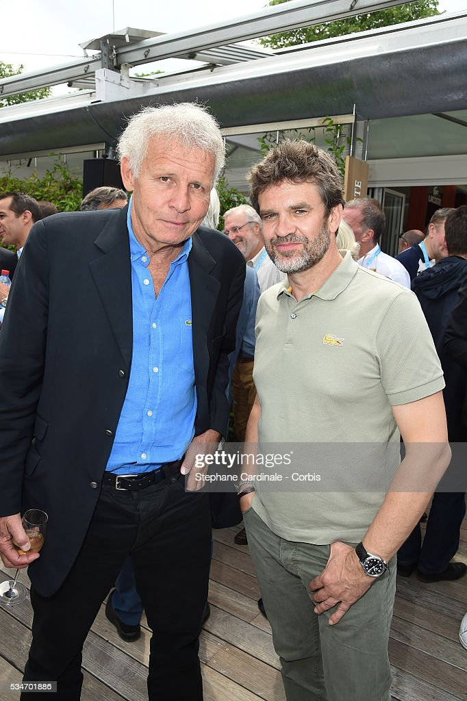 Journalists Patrick poivre d'Arvor and Herve Mathoux attend day six of the 2016 French Open at Roland Garros on May 27, 2016 in Paris, France.