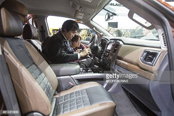 Journalists photograph the new Nissan Titan during its unveiling at the 2015 North American International Auto Show in Detroit Michigan January 12...