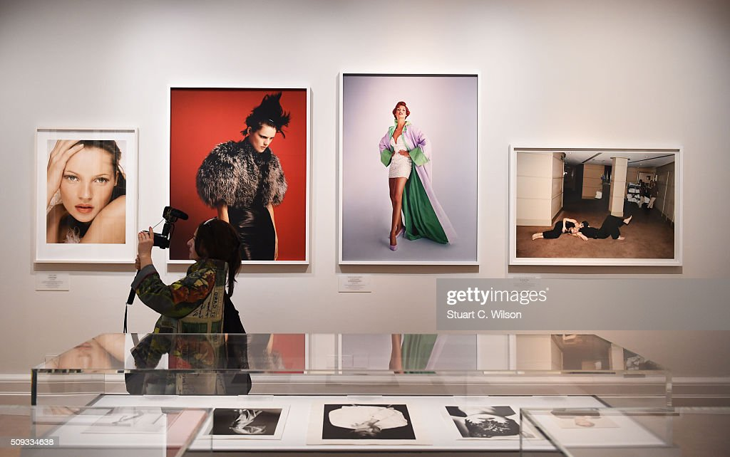 A Journalists photographs during the press preview for 'Vogue 100: A Century of Style' exhibiting the photographs that has been commissioned by British Vogue since it was founded in 1916 at National Portrait Gallery on February 10, 2016 in London, England.