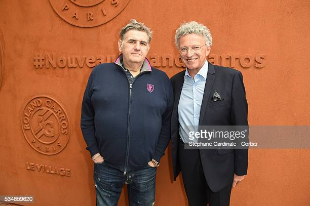 Journalists Pierre Menes and Nelson Monfort attend day seven of the 2016 French Open at Roland Garros on May 28 2016 in Paris France