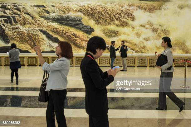 Journalists prepare to attend a press conference prior to the opening session of the 19th Communist Party Congress at the Great Hall of the People in...