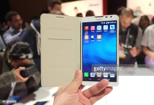 Journalists preview Huawei's new smart phone Hyawei Ascend Mate 2 4G during a press event at the Mandalay Bay Convention Center for the 2014...
