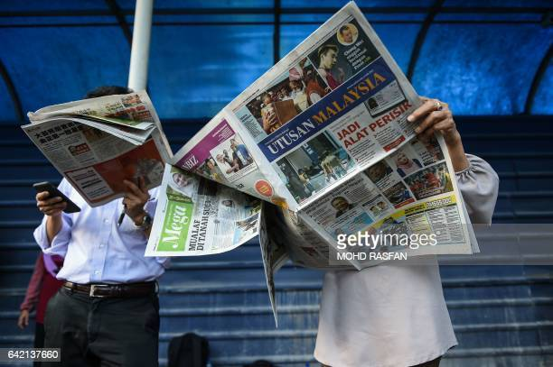 Journalists read newspapers with reports about the killed of North Korean man suspected to be Kim JongNam halfbrother of North Korean leader Kim...