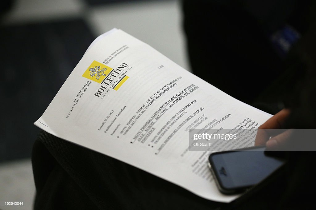 Journalists read the 'Motu Proprio' document in a press conference in the Holy See Press Room on February 25, 2013 in Vatican City, Vatican. The 'Motu Proprio' outlines the changes to Roman Catholic church law that Pope Benedict XVI has approved which can enable the conclave to select his successor beginning sooner than15 days after the papacy becomes vacant. The Pontiff will hold his last weekly public audience on February 27, 2013 before he retires the following day. Pope Benedict XVI has been the leader of the Catholic Church for eight years and is the first Pope to retire since 1415. He cites ailing health as his reason for retirement and will spend the rest of his life in solitude away from public engagements.