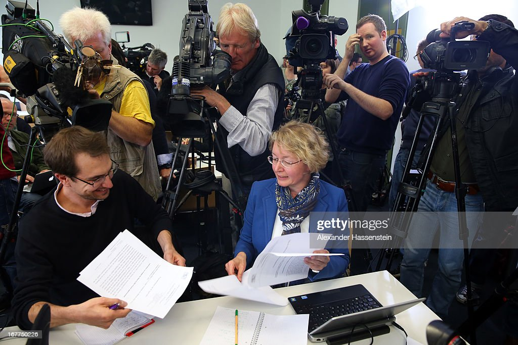 Journalists read the press statement of the Oberlandgericht Muenchen court during a press conference after the the lottery draw for the 50 media spots inside the courtroom for the upcoming NSU murder trial on April 29, 2013 in Munich, Germany. This the second accreditation process for the trial, which manay analysts are dubbing the trial of the decade and is scheduled to begin May 6, after lawsuits filed by Turkish media were upheld and the Munich court responded by redoing all accreditations. Eight of the ten victims of the NSU neo-Nazi murder trio were Turkish and one was Greek, and Turkish and Greek media are now guaranteed a small portion of the 50 seats reserved for media after no foreign media were given seats in the first accreditation process.
