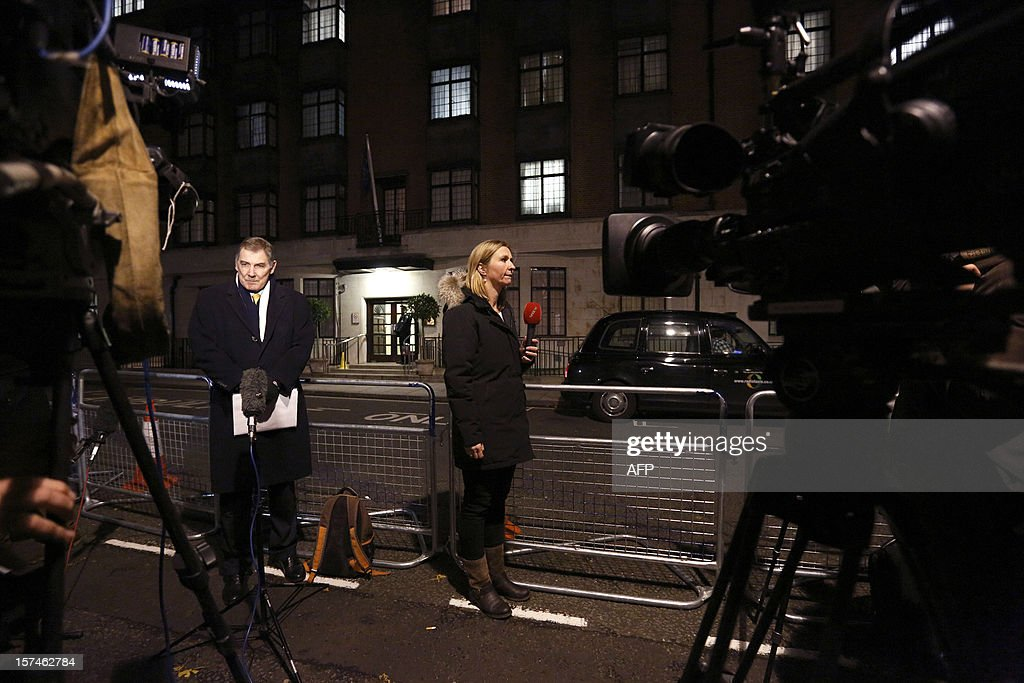 Journalists report from outside King Edward the VII hospital in London on December 3, 2012, where Catherine, the Duchess of Cambridge, is resting for suffering severe morning sickness. Prince William's wife Catherine is pregnant with their first child, St James's Palace said, in an eagerly awaited announcement about a baby destined to be Britain's future king or queen.