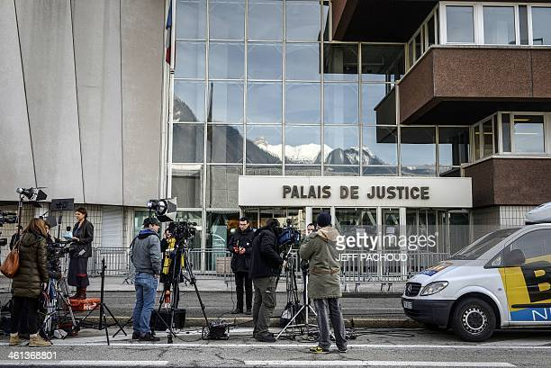 Journalists report in front of the courthouse of Albertville ahead of a press conference by a French prosecutor regarding the inquiry into Michael...