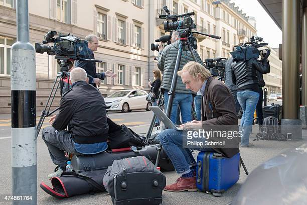 Journalists report in front of the hotel Baur au Lac Zurich in which Swiss police detained top FIFA football officials as part of a US investigation...