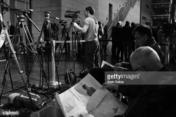 Journalists settle in for what will possibly be a long night waiting for the leadership of the four leading political parties to emerge from meeting...
