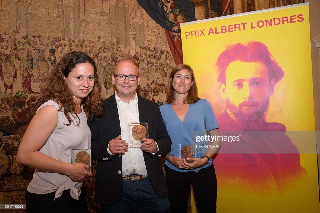 Journalists Sophie Nivelle-Cardinale (L), Etienne Huver (C) and Claire Meynial (R) pose for a photograph after being awarded the Prix Albert Londres at the French Ambassador's residence in west London, on May 27, 2016. A series of reports from Africa and a film about the war in Syria were awarded the Prix Albert Londres for francophone journalists on Friday, as organisers drew attention to the need to protect whistle-blowers. / AFP / LEON