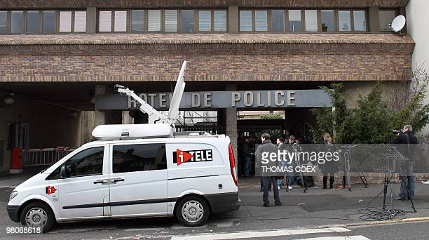 Journalists stand in front of Melun's police station south of Paris where five spanish people are being heard on March 20 2010 The five from Spain's...