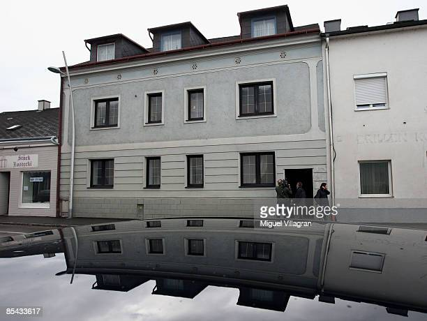 Journalists stand in front of the house where Josef Fritzl imprisoned his daughter in a cellar for 24 years and fathered seven children with her on...
