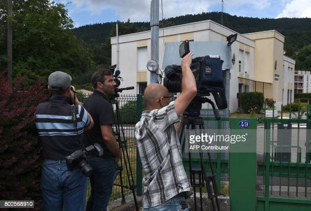 Journalists stand on June 28 2017 in the front of the Gendarmerie in SaintEtienneLesRemiremont eastern France where Murielle Bolle was taken in for...