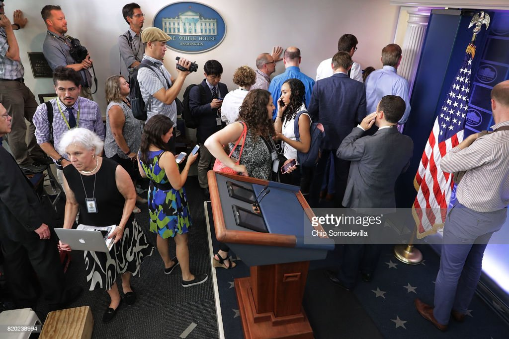 Journalists stand outside the entrance to the White House press office after it was learned that Press Secretary Sean Spicer has resigned July 21, 2017 in Washington, DC. Reports say that Spicer quit after disagreeing with President Donald Trump's decision to hire Anthony Scaramucci, a Wall Street financier and longtime supporter, to the position of White House communications director.