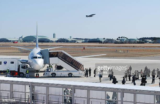 Journalists surround a Skymark jetliner at Ibaraki airport in Omitama Ibaraki prefecture about 80 kilometres northeast of Tokyo the first flight to...