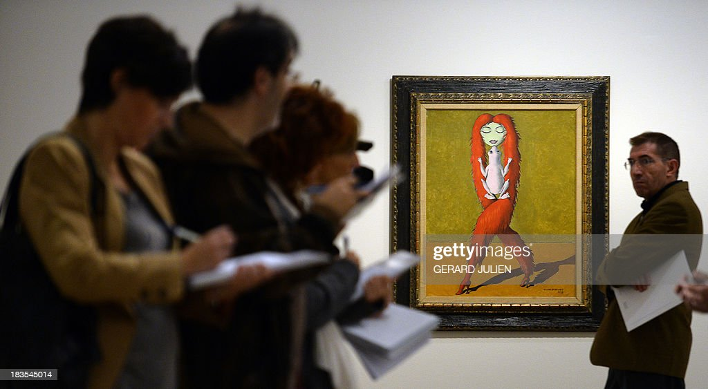 Journalists take notes past the painting 'Objet qui rêve II'' by Victor Brauner during the exhibition entitled 'Surrealism and the Dream' at the Thyssen-Bornemisza museum in Madrid, on October 7, 2013.