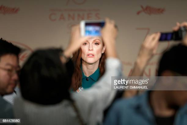 TOPSHOT Journalists take photos of US actress Julianne Moore arriving on May 18 2017 to attend a press conference for the film 'Wonderstruck' at the...