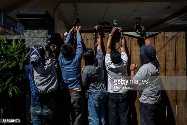 Journalists take pictures outside the villa where Schapelle Corby is living as she prepares for deportation from Indonesia on May 27 2017 in Bali...