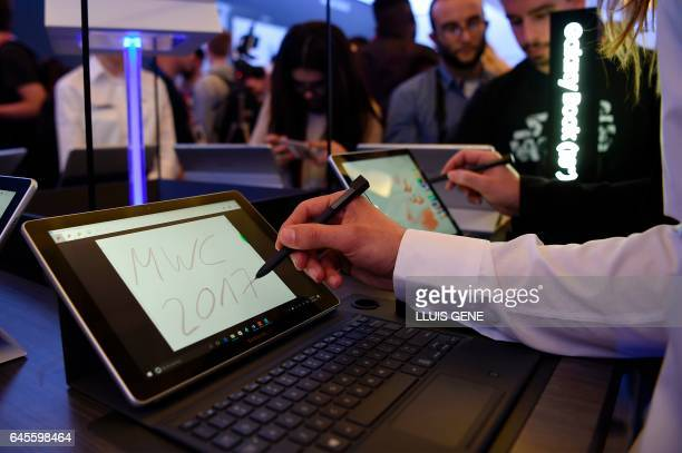 Journalists test the tablet Samsung Galaxy Book after its presentation on February 26 2017 in Barcelona on the eve of the Worl Mobile Congress...