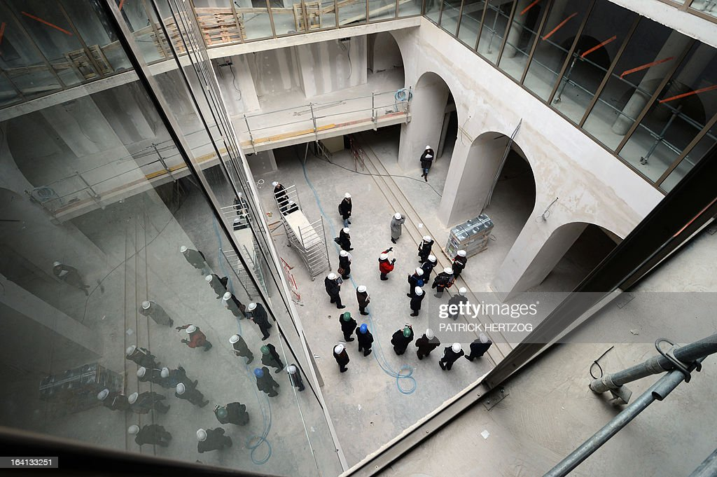 Journalists visit the building site of the Bibliothèque Nationale Universitaire (BNU) in Strasbourg, on March 20, 2013.