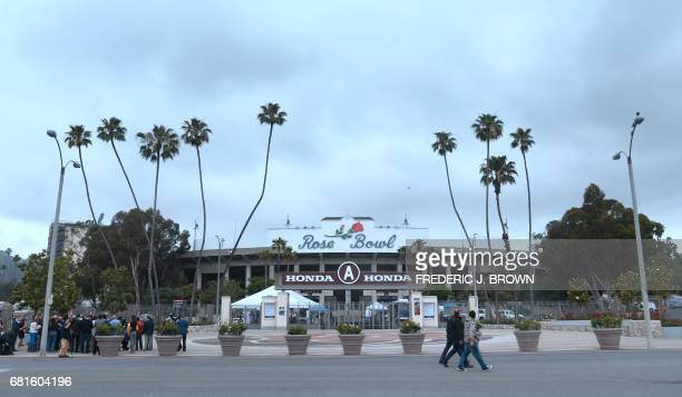 Journalists visit the Rose Bowl as part of a tour of Olympic venues as officials attend the IOC Evaluation Commission session in Los Angeles...