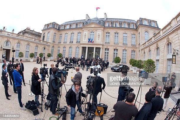 Journalists wait as France's ministers leaving the Elysee presidential palace on May 9 2012 in Paris at the end of the last weekly cabinet meeting of...