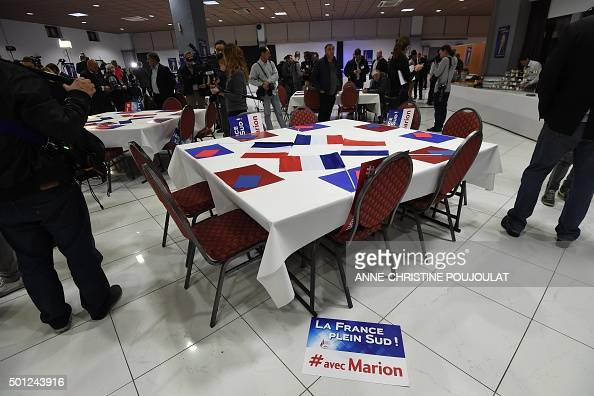 Journalists wait for the arrival of the French farright National Front party top candidate in the ProvenceAlpesCote d'Azur region after the...