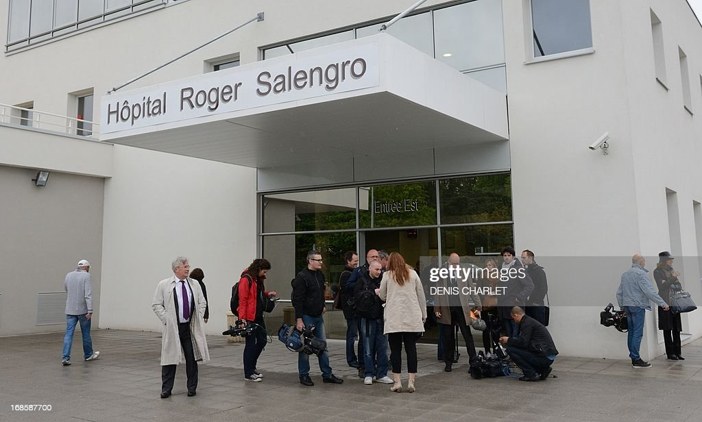 Journalists wait in front of Roger Salengro Hospital (CHRU) in the northern French city of Lille on May 11, 2013. French health authorities said early May 12 that a second person, now hospitalised at the CHRU, had contracted a deadly new SARS-like virus, after sharing a hospital ward with the first victim identified in the country while both were hospitalised in Valenciennes. The latest victim shared a hospital room with a 65-year-old man who is in intensive care in Lille after being diagnosed with the virus that has already killed 18 people, mostly in Saudi Arabia.