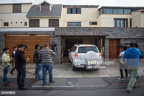 Journalists wait outside Peruvian former President Ollanta Humala's home in Lima on July 12 2017 Prosecutors in Peru have requested the arrest of...