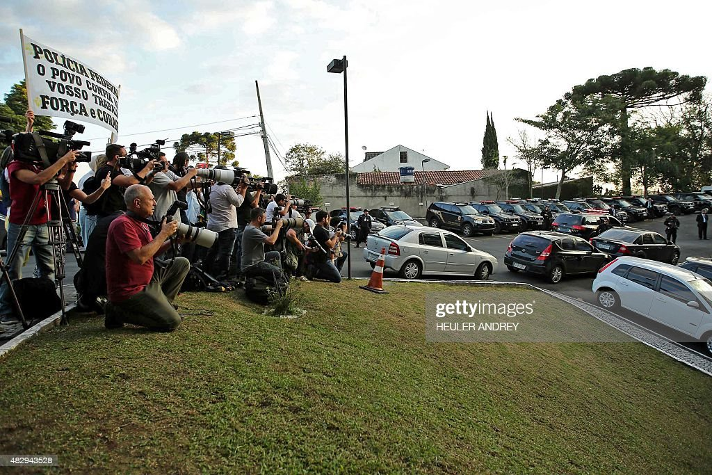 Journalists wait outside the Federal Police headquarters in Curitiba Brazil on August 4 as Brazilian former chief of staff Jose Dirceu is expected to...