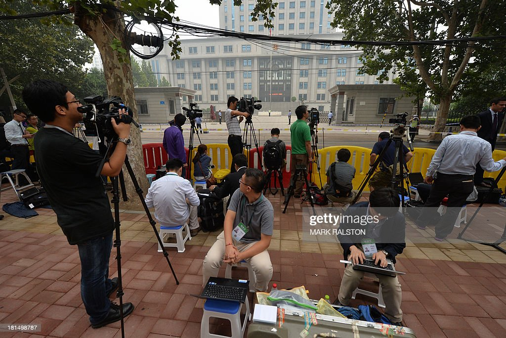 Journalists wait outside the Intermediate People's Court before disgraced politician Bo Xilai arrived for his sentencing in Jinan, Shandong Province on September 22, 2013. The verdict in the case of China's fallen political star Bo Xilai, will cap an extraordinary scandal involving bribes, murder, illicit love, political infighting, and a colourful yet tightly controlled trial. AFP PHOTO/Mark RALSTON