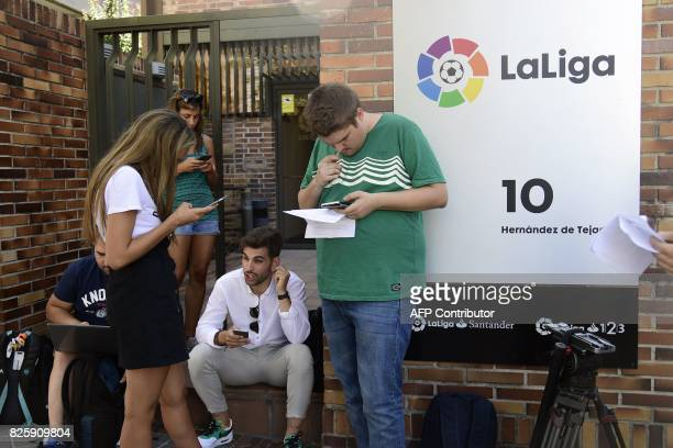 Journalists wait outside the Spanish Professional Football League 'La Liga' headquarters in Madrid on August 3 2017 Spain's La Liga refused to accept...