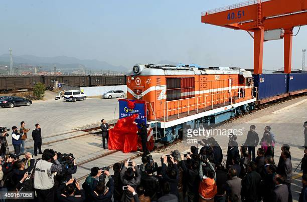 Journalists wait to take photos of the first cargo train 'Yixinou' from China's Yiwu to Spainish capital Madrid in a train station in Yiwu east...