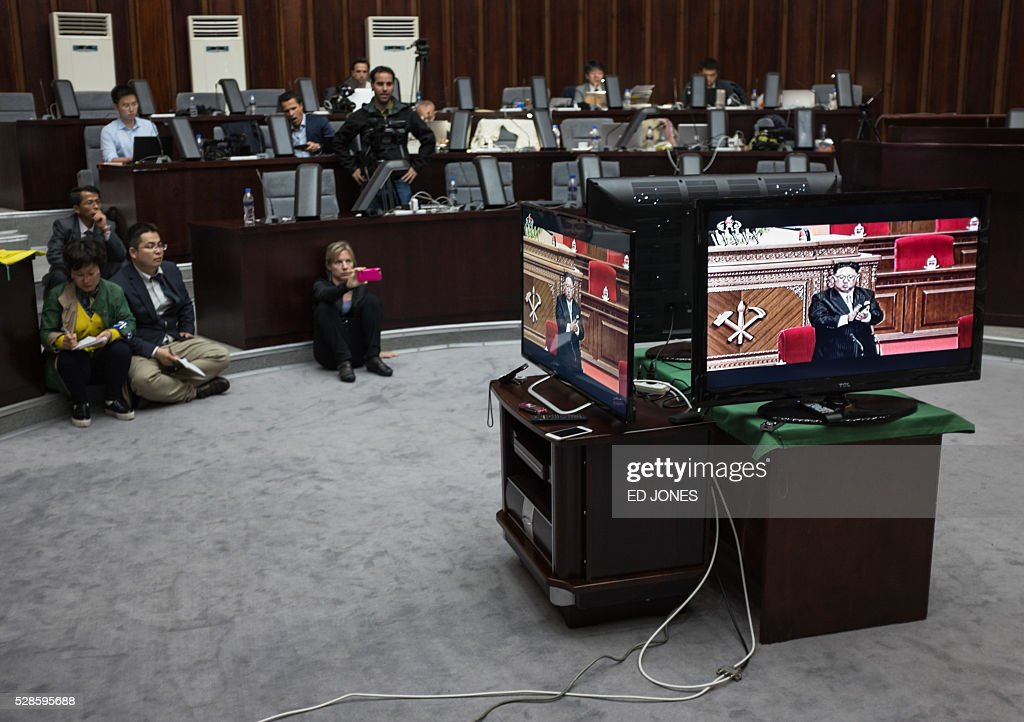 Journalists watch a television broadcast showing a speech by North Korean leader Kim Jong-Un at the 7th Workers Party Congress, in the media room of the Yanggakdo hotel in Pyongyang on May 6, 2016. North Korea kicked off its first ruling party congress for nearly 40 years, with state media lauding the isolated country's 'prestige' as a nuclear power while maintaining a news blackout on the event itself. / AFP / Ed Jones