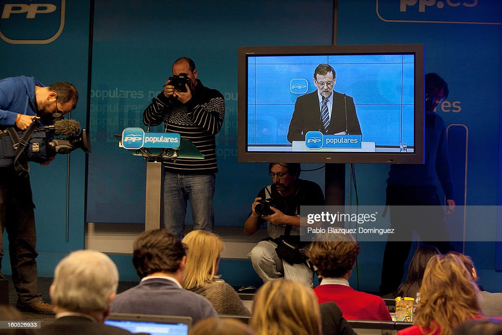 Journalists watch Mariano Rajoy's conference of the PP national executive comitee on a tv screen from the Press Room in the PP headquarters on February 2, 2013 in Madrid, Spain. Spanish reports alleged Rajoy and other conservative politicians received regular payments from a previously undisclosed account run by the treasurers of his Popular Party from 1990 to 2008.