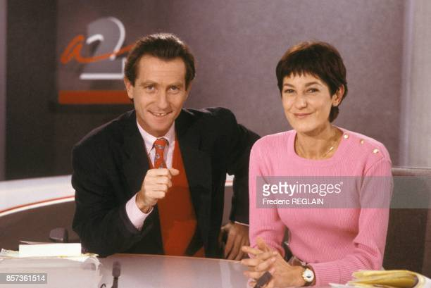 Journalists William Leymergie and Brigitte Simonetta on French Tv channel Antenne 2 on October 1988 in Paris France