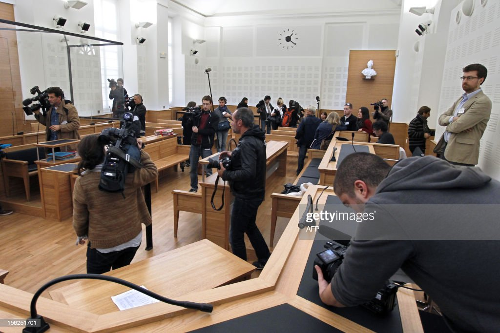 Journalists work in a courtroom on November 12, 2012 in Ajaccio prior to the start of the trial of 19-year-old boy for shooting dead his parents and 10-year-old twin brothers in 2009. The accused, named as Andy, exterminated the entire family in August 2009 with his father's Winchester rifle in an act he said occurred in a trance-like state. AFP PHOTO / PASCAL POCHARD CASABIANCA