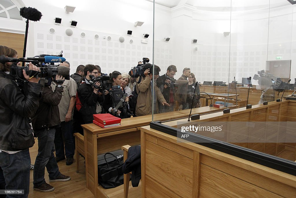 Journalists work in a courtroom on November 12, 2012 in Ajaccio prior to the start of the trial of 19-year-old boy for shooting dead his parents and 10-year-old twin brothers in 2009. The accused, named as Andy, exterminated the entire family in August 2009 with his father's Winchester rifle in an act he said occurred in a trance-like state.